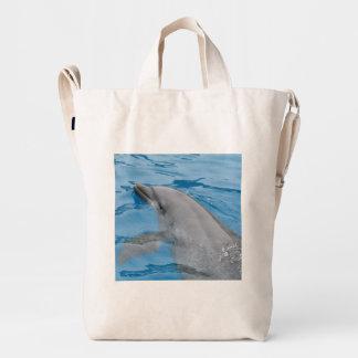 Dolphin Swimming In Deep Blue Ocean Waters Duck Bag