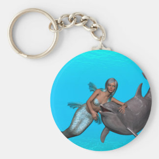 Dolphin swimming with a mermaid keychain