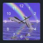 """Dolphins and Rainbow Square Wall Clock<br><div class=""""desc"""">Two happy dolphins jumping out of the water.</div>"""