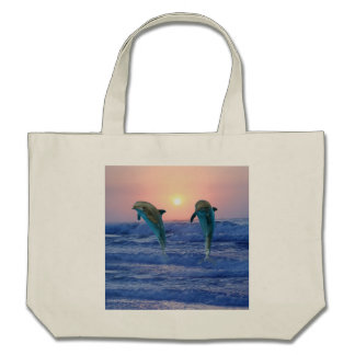 Dolphins at sunrise canvas bag