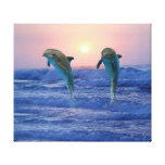 Dolphins at sunrise canvas print