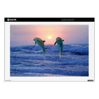 Dolphins at sunrise laptop skin