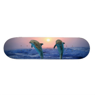 Dolphins at sunrise skateboard deck