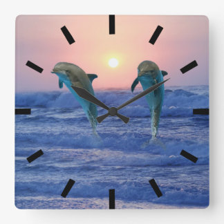 Dolphins at sunrise square wall clock