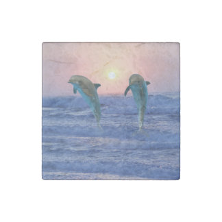 Dolphins at sunrise stone magnet