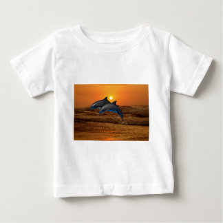 Dolphins at sunset baby T-Shirt
