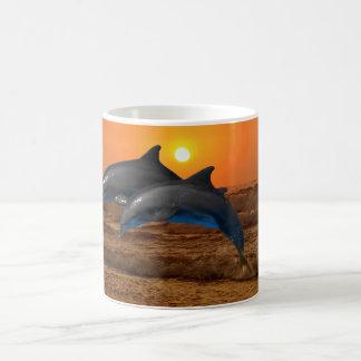 Dolphins at sunset coffee mug