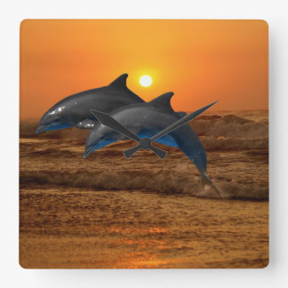 Dolphins at sunset square wall clock