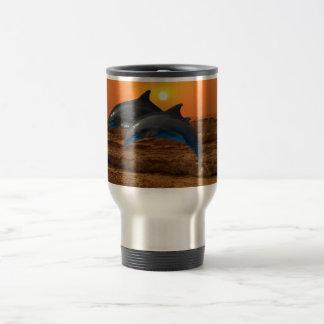 Dolphins at sunset travel mug
