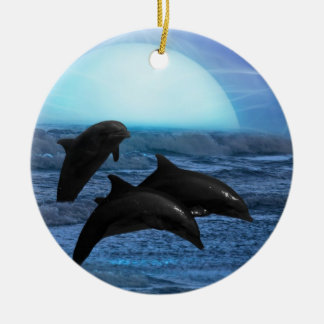 Dolphins by moonlight christmas tree ceramic ornament