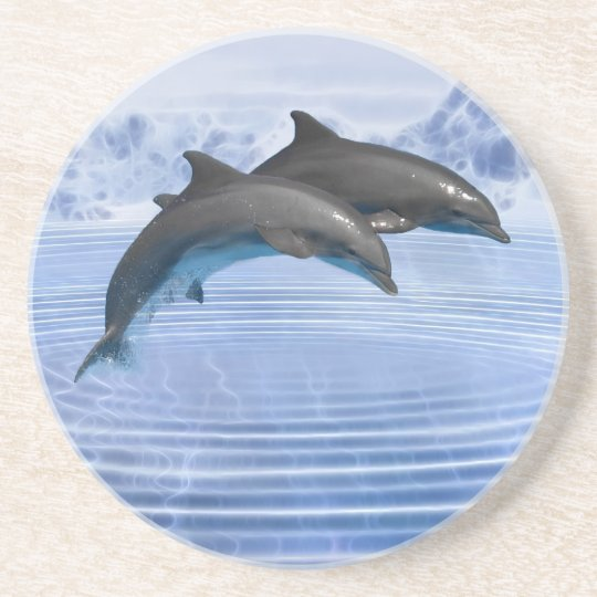 Dolphins in the clear blue sea drink coaster