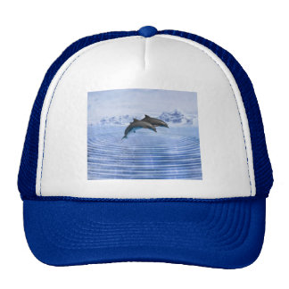 Dolphins in the clear blue sea trucker hat