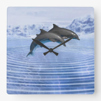 Dolphins in the clear blue sea square wall clock