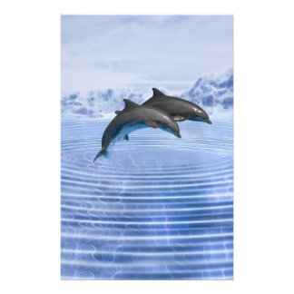 Dolphins in the clear blue sea stationery