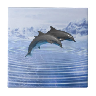 Dolphins in the clear blue sea tile