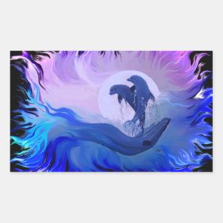 Dolphins in the moonlight rectangular sticker