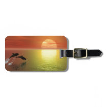 dolphins jumping ocean sunset bag tag