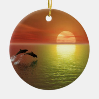 dolphins jumping ocean sunset ceramic ornament
