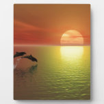 dolphins jumping ocean sunset plaque