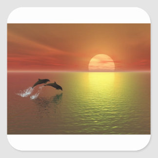 dolphins jumping ocean sunset square sticker