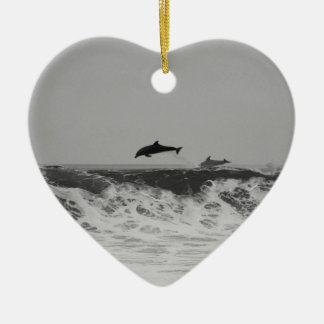 Dolphins jumping through waves in black & white ceramic ornament