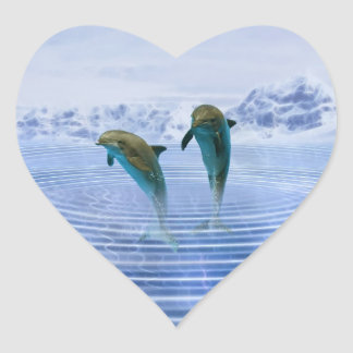 Dolphins make ripples heart sticker