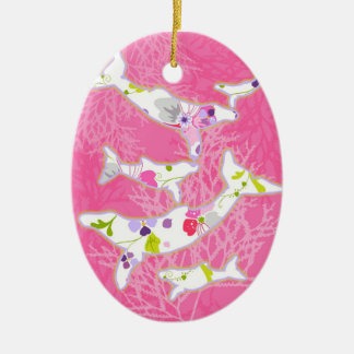 Dolphins on floral pink background. christmas ornament