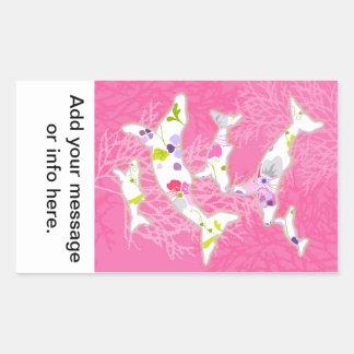 Dolphins on floral pink background. rectangular sticker