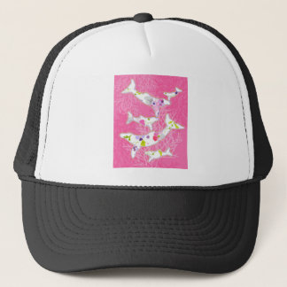 Dolphins on floral pink background. trucker hat