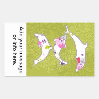 Dolphins on pastel green background. rectangular sticker