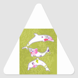 Dolphins on pastel green background. triangle sticker