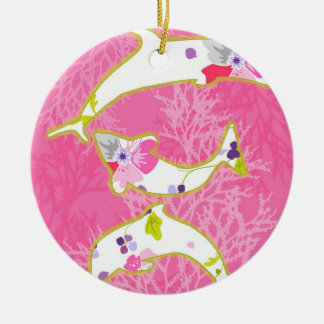 Dolphins on pink background. christmas ornament