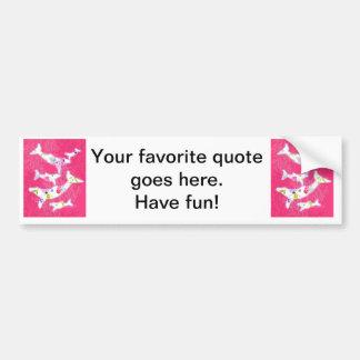 Dolphins on plain pink background. bumper sticker