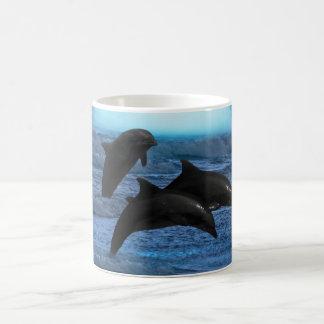 Dolphins playing at moonlight mug