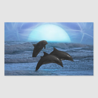 Dolphins playing at moonlight rectangular sticker