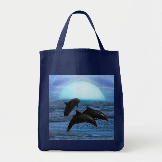Dolphins playing at moonlight tote bag