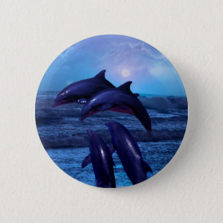 Dolphins playing in the ocean button