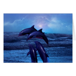 Dolphins playing in the ocean card