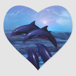 Dolphins playing in the ocean heart sticker