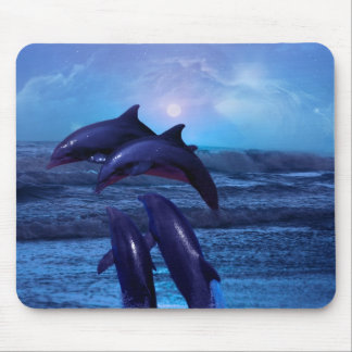 Dolphins playing in the ocean mouse pad