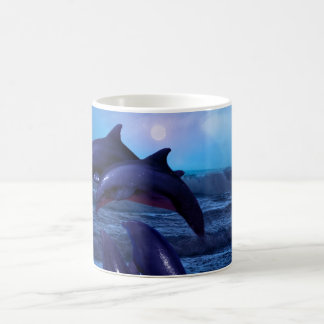 Dolphins playing in the ocean coffee mugs