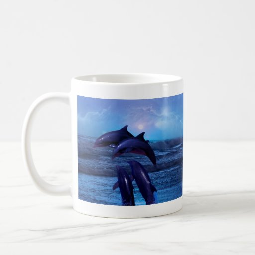 Dolphins playing in the ocean mug