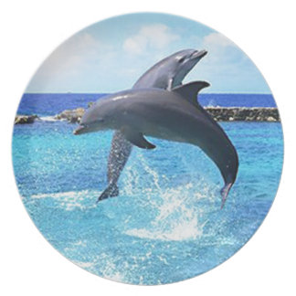 Dolphins playing in the ocean dinner plate