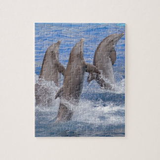 Dolphins standing out of the water jigsaw puzzle