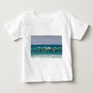 Dolphins surfing a wave baby T-Shirt