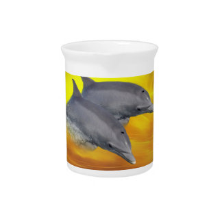 Dolphins surfing the waves beverage pitcher