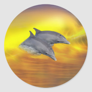 Dolphins surfing the waves classic round sticker
