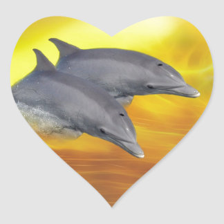 Dolphins surfing the waves heart sticker