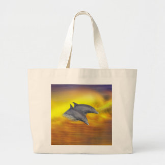 Dolphins surfing the waves large tote bag