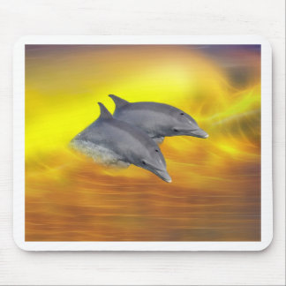 Dolphins surfing the waves mouse pad